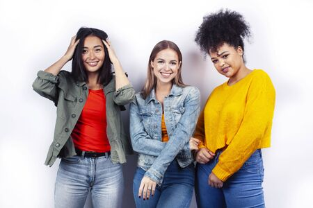Photo pour diverse nation girls group, teenage friends company cheerful having fun, happy smiling, cute posing isolated on white background, lifestyle people concept - image libre de droit