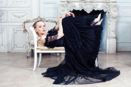 Photo pour young pretty woman in black lace fashion style dress posing in rich interior of royal hotel room, luxury lifestyle people concept - image libre de droit
