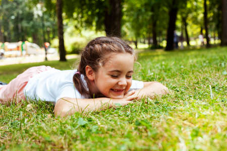 Photo for little cute caucasian girl playing cheerful in green park at summer, lifestyle people concept - Royalty Free Image