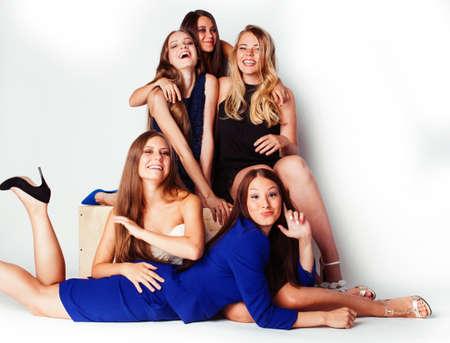 Photo pour many girlfriends hugging celebration on white background, smiling talking chat closeup, lifestyle people concept - image libre de droit