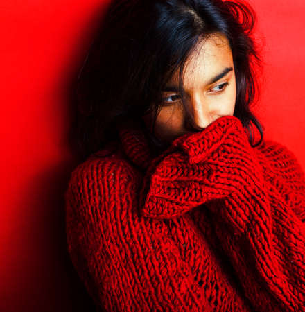 Photo pour young pretty indian girl in red sweater posing emotional, fashion hipster teenage, lifestyle people concept - image libre de droit