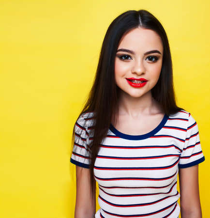 Photo for lifestyle people concept: pretty young school teenage girl having fun happy smiling on yellow background - Royalty Free Image
