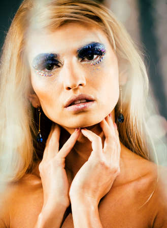 Photo pour beauty young snow queen in fairy flashes with hair crown on her head close up in cold blue light - image libre de droit