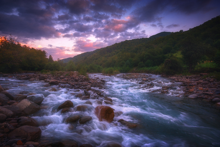 Photo for beautiful sunrise over fast flowing mountain river - Royalty Free Image