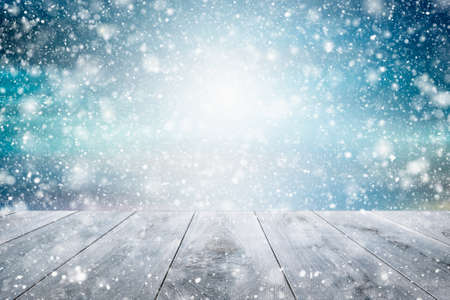 Photo pour Winter snow background, beautiful light and snow flakes with empty wooden table. copy space. - image libre de droit