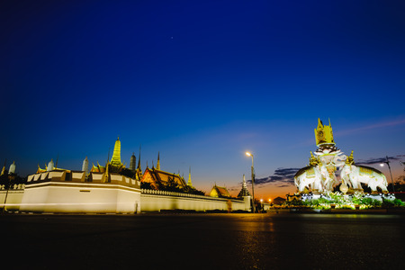 Night view image of  statues of Thai White Elephants and symbols Thailand King Rama 9,in front of the Grand Palace or Emerald Buddha Temple.