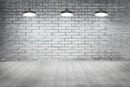 room white brick grunge wall and wood floor with ceiling lamp for background