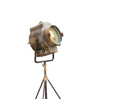 Vintage Movie Light on a stand, isolated background and blank text