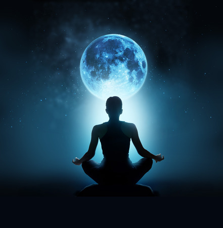 Abstract woman are meditating at blue full moon with star in dark night sky background, Moon original image from NASA.gov