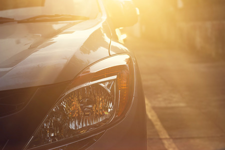 headlights of car at light sunset on the street background