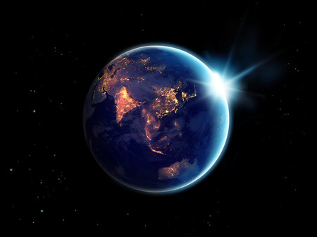 Foto de City lights at night in planet earth with with sun rising, - Imagen libre de derechos