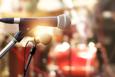 Photo pour Microphone on concert stage background - image libre de droit