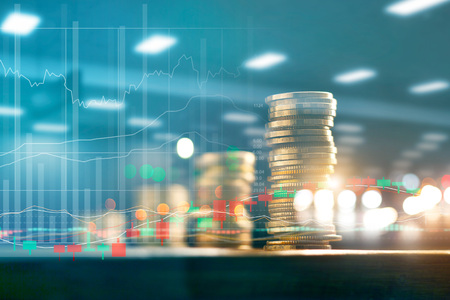 Finance and business investment concept. Graph and rows with statistic growth of coins on table.