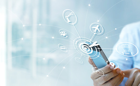 Photo pour Industry 4.0 concept, Businessman using smartphone with icon target and data networking exchange in manufacturing technologies on virtual modern interface. - image libre de droit