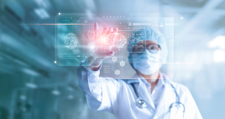 Foto de Doctor, surgeon analyzing patient brain testing result and human anatomy on technological digital futuristic virtual computer interface, digital holographic, innovative in science and medicine concept - Imagen libre de derechos