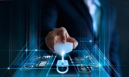 Foto de Data protection concept. GDPR. EU. Cyber security. Business man using mouse computer with padlock icon and internet technology network on blue background. - Imagen libre de derechos
