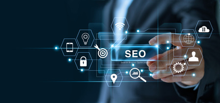 Photo pour SEO Search Engine Optimization Marketing concept. Businessman holding word SEO in hand and searching on network connection. Digital online marketing. Business technology. - image libre de droit