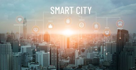 Foto de Smart city with smart services and icons, network connection and augmented reality, internet of things, communication, sunset background. - Imagen libre de derechos