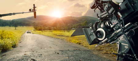 Foto de Behind the scenes making of movie and TV commercial. Camera of movie and video production. Film Crew. B-roll, and crew team in outdoor nature background. - Imagen libre de derechos