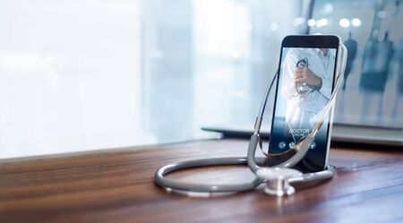 Photo pour Doctor online, online medical communication network  with patient, Online medical consultation, Doctor through the phone screen using stethoscope checks and analysis health care. - image libre de droit