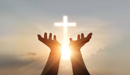 Photo pour Man hands palm up praying and worship of cross, eucharist therapy bless god helping, hope and faith, christian religion concept on sunset background. - image libre de droit