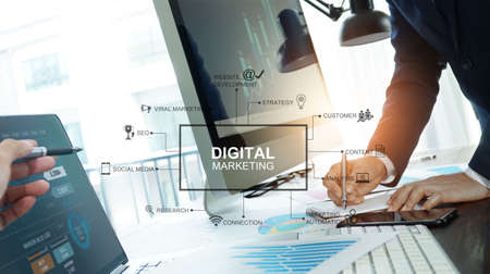 Photo pour Digital marketing, Business team writing information and analysis sale data and graph growth, Banking, Strategy and planning of business on network connection, Solution analyzing and development contents. - image libre de droit