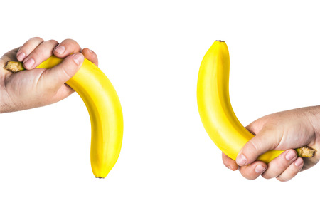 two men\'s hands holding the big bananas up and down