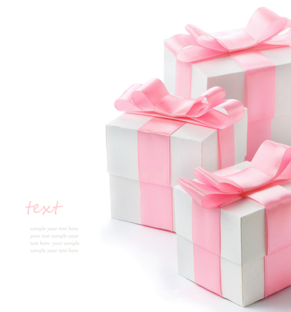 Foto de Gift white box with pink satin ribbon isolated on white background, congratulations on Women's Day, mum's day, Valentine's day, happy birthday - Imagen libre de derechos