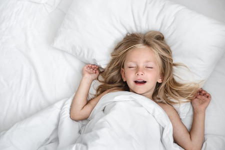 Photo for little child girl sleeping in the bed - Royalty Free Image