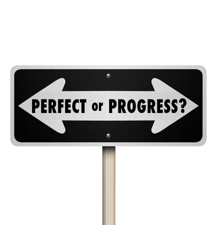 Perfect or Progress arrow road or street sign to illustrate the different opposite paths of aiming for perfection and delaying moving forward or progressing without waiting for perfection
