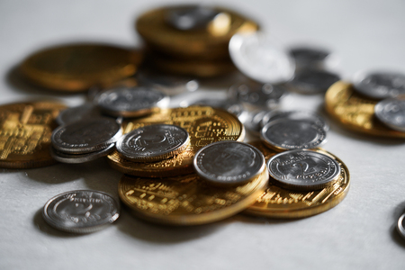 Photo pour Macro shot detail of golden and silver color coin stacks on dark background with copy space for text. Business and finance growth, saving money, investment and interest concept. selective focus - image libre de droit