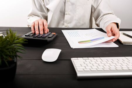 Photo for Close up of man accountant or banker making calculations. Close up of man accountant or banker making calculations. Savings, finances and economy concept - Royalty Free Image