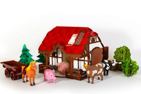 Photo pour Toy house made of cardboard paints with toy pets, farm yard on a light background - image libre de droit