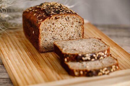 Foto für whole wheat gluten free bread with flax seads sunflower chia seads sesame. side view with copy space - Lizenzfreies Bild