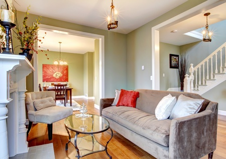 Green interior with cherry wood floor and nice furniture