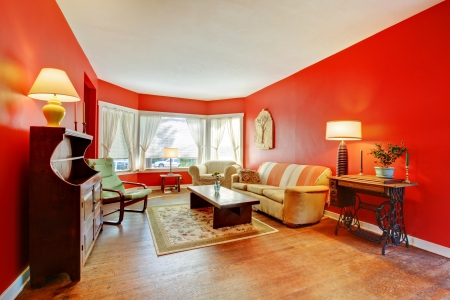 Large red living room with hardwood and antique furniture with lamps