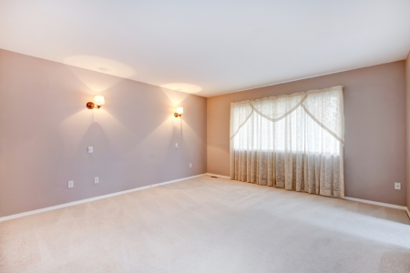 Large beige bedroom interior with lights and curtains.
