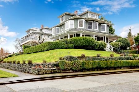 Foto de Large luxury green craftsman classic American house exterior  - Imagen libre de derechos
