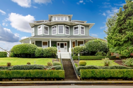 Large luxury green craftsman classic American house exterior