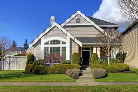 Classic new beige American house exterior in the spring