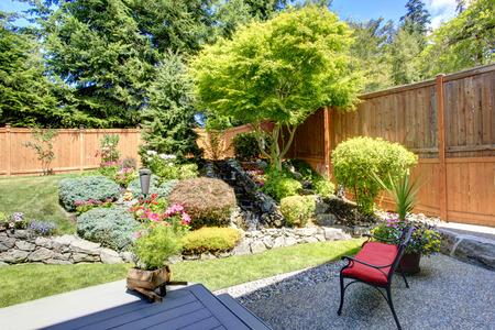 Foto de Beautiful landscape design for backyard garden with small bench - Imagen libre de derechos