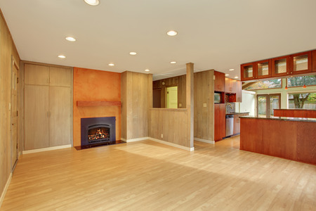 Nice living room with hard wood floor and fireplace.