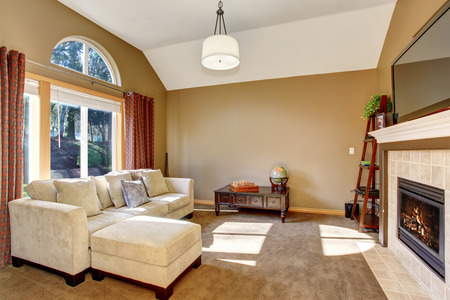 The perfect family living room with cozy carpet and wonderful lighting.