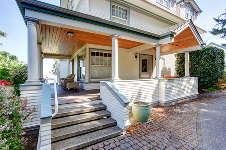 Foto de Front porch with chairs and columns of craftsman style home. - Imagen libre de derechos