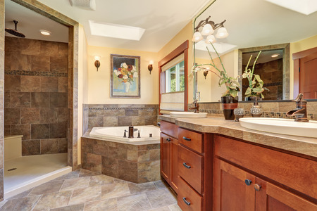 Lovely master bathroom with stone floor and large shower.House interior.