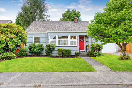 Photo for Exterior of small American house with blue paint and red entrance door. Northwest, USA - Royalty Free Image