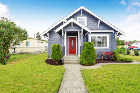 Foto de Classic American house exterior with siding trim, red entry door and concrete floor porch. Northwest, USA - Imagen libre de derechos