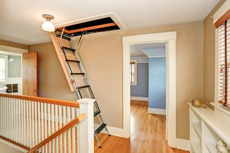Photo pour Hallway interior with folding attic ladder. Northwest, USA - image libre de droit