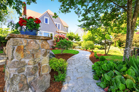 American craftsman two level house exterior. Nice landscape design around. Northwest, USA