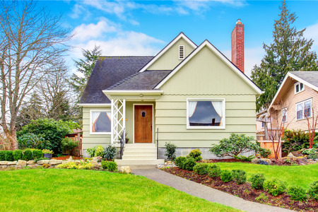 Photo for Small American house with well kept lawn and nice landscaping desing around. Northwest, USA - Royalty Free Image